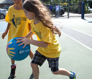 girl dribbling ball
