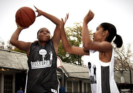 Women playing basketball in Central Park