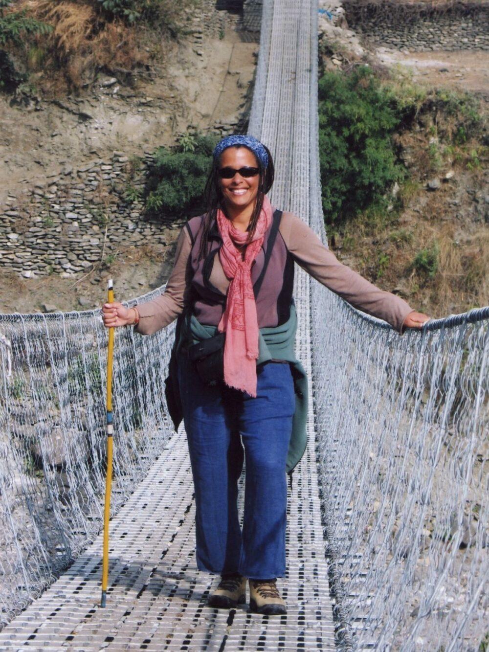 Dr. Finney crossing a rope bridge in Nepal