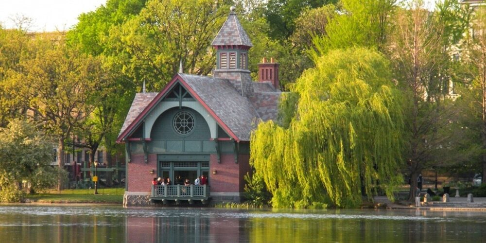 The Dana Center pictured on the banks of the Harlem Meer, surrounded by trees