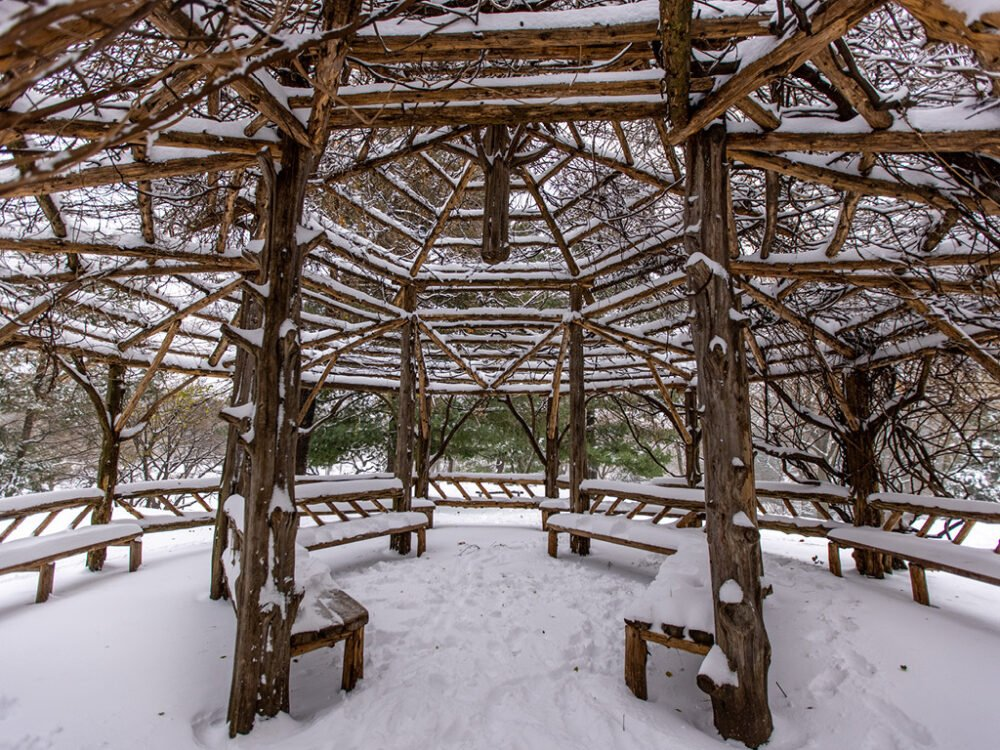 The interior of the rustic structure is pictured under a layer of fresh snow