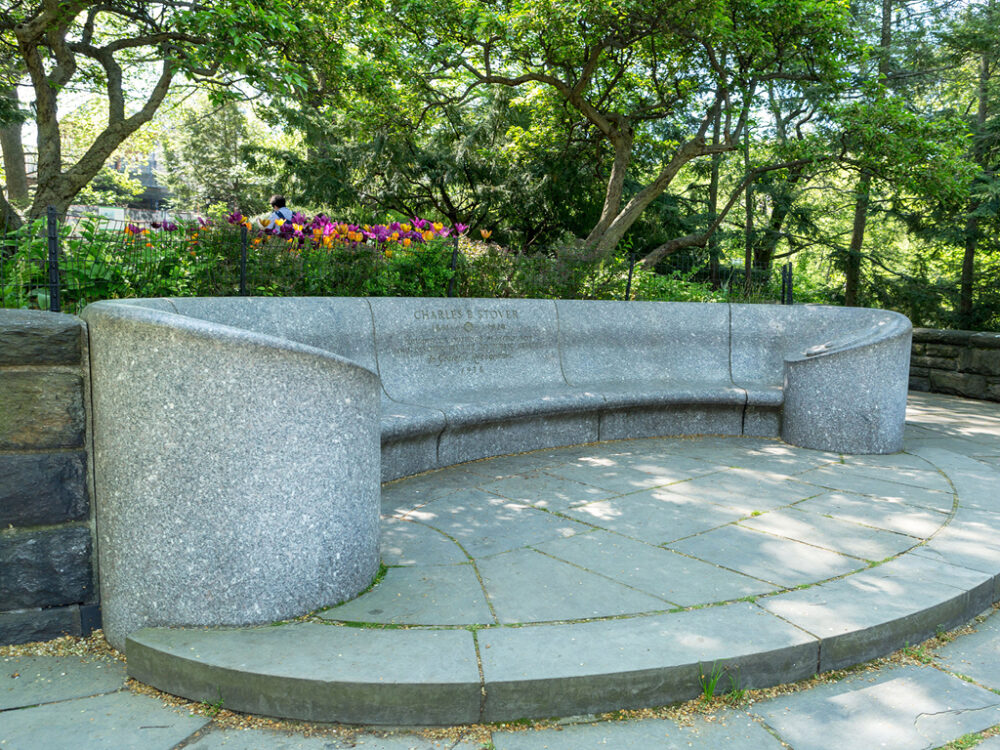 An empty Stover Bench is pictured in dappled sunlight