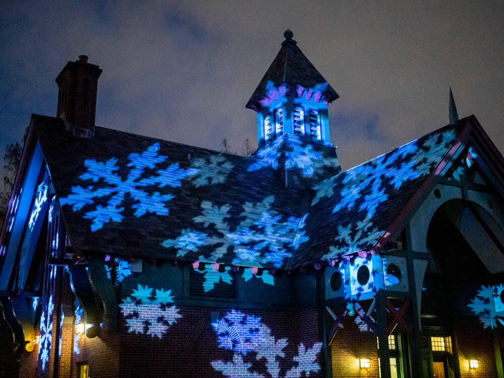 Snowflakes projected onto the Dana Center at night