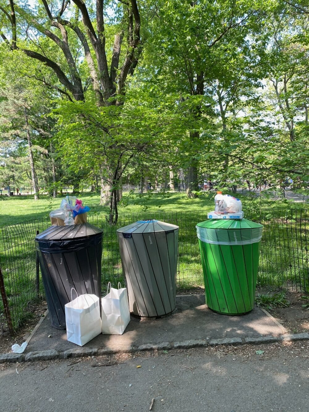 Trash cans pictured full to overflowing