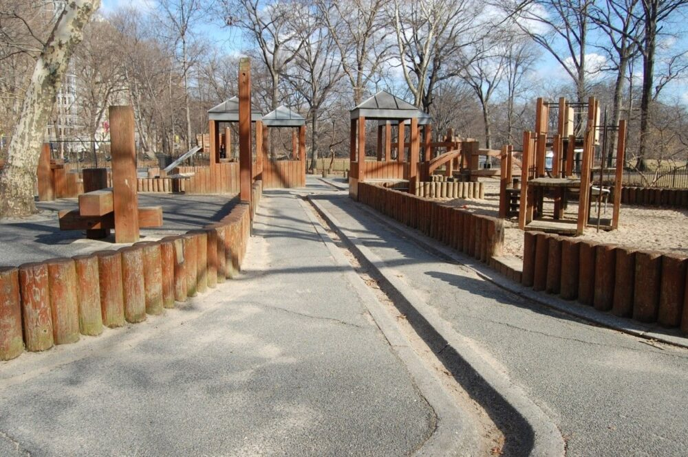 A shallow concrete trench is a feature of the playground before reconstruction