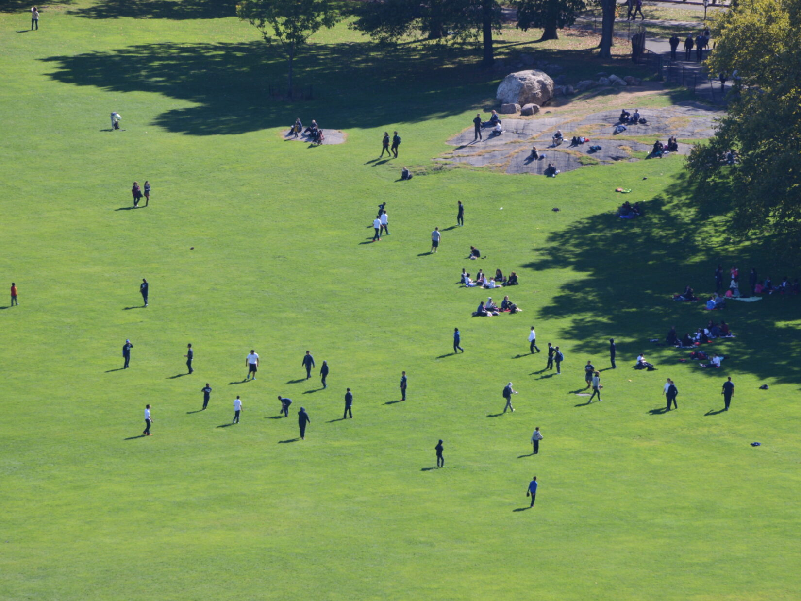 An aerial view of the Sheep Meadow showing people playing football
