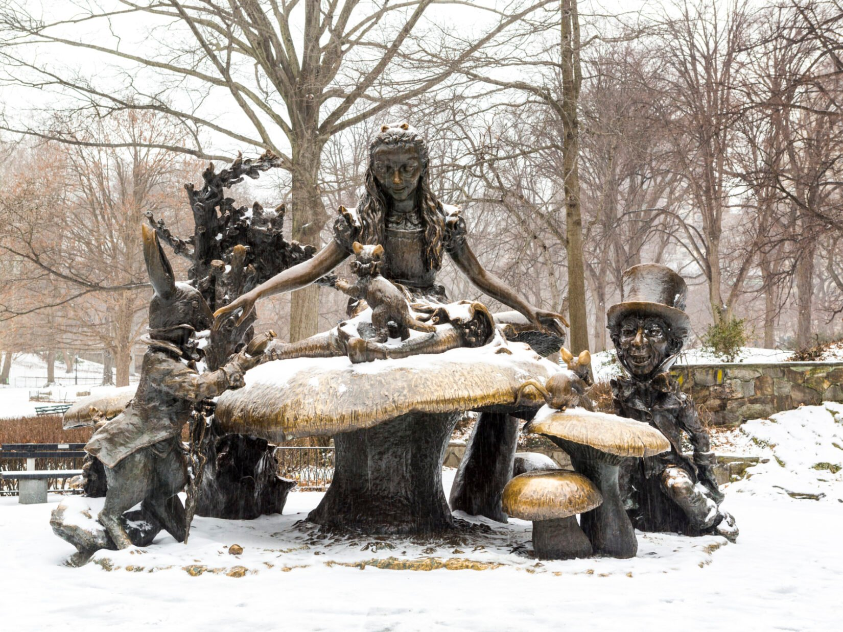 The Alice in Wonderland statue, depicted with winter snow
