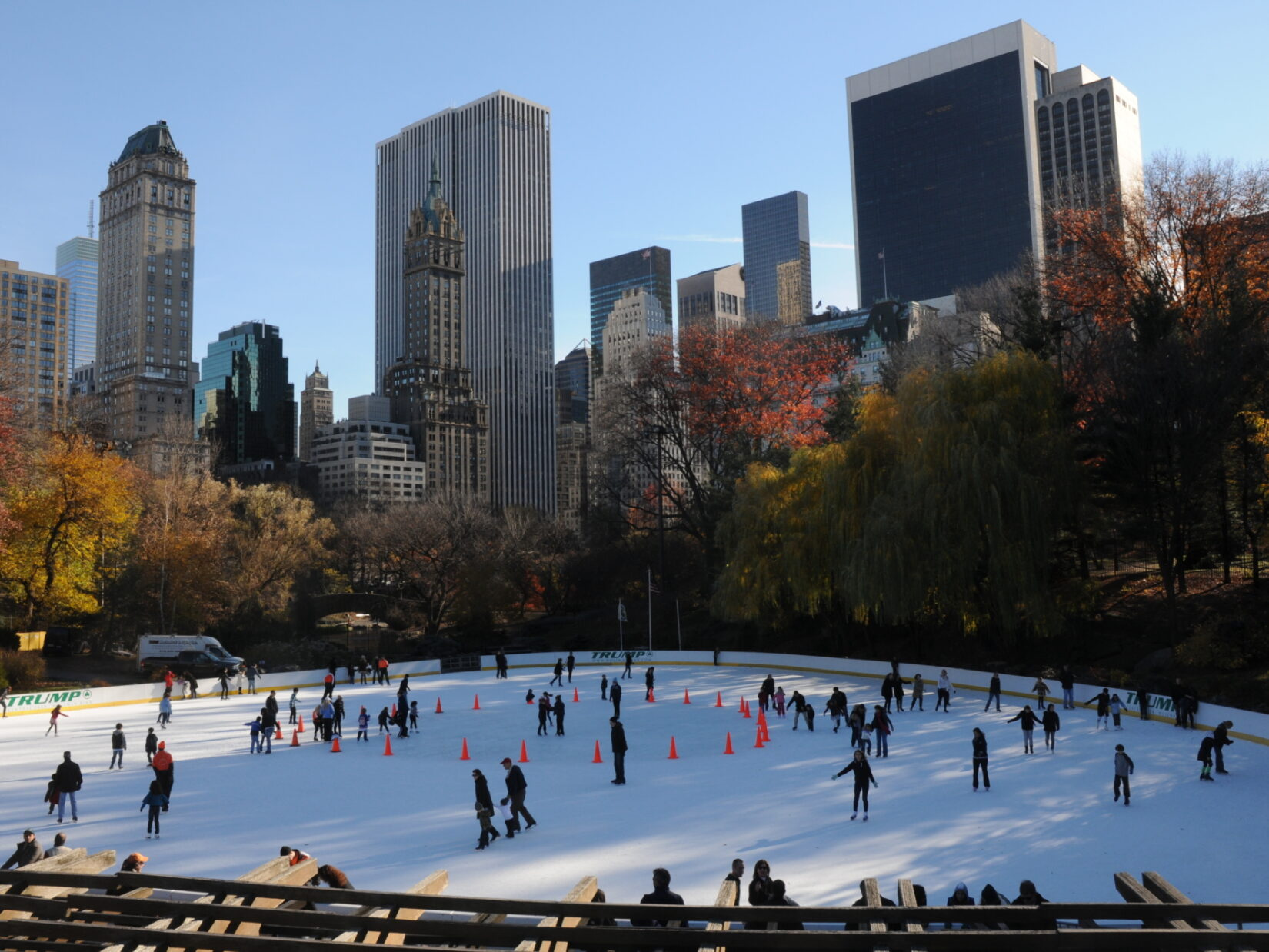 Skaters enjoy the Wollman Rink beneath the skyline