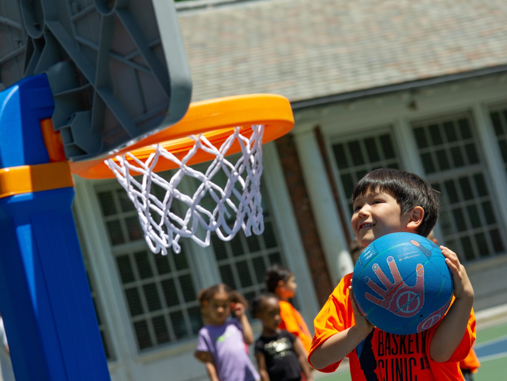 A young hoopster aiming for a toddler-appropriate basket