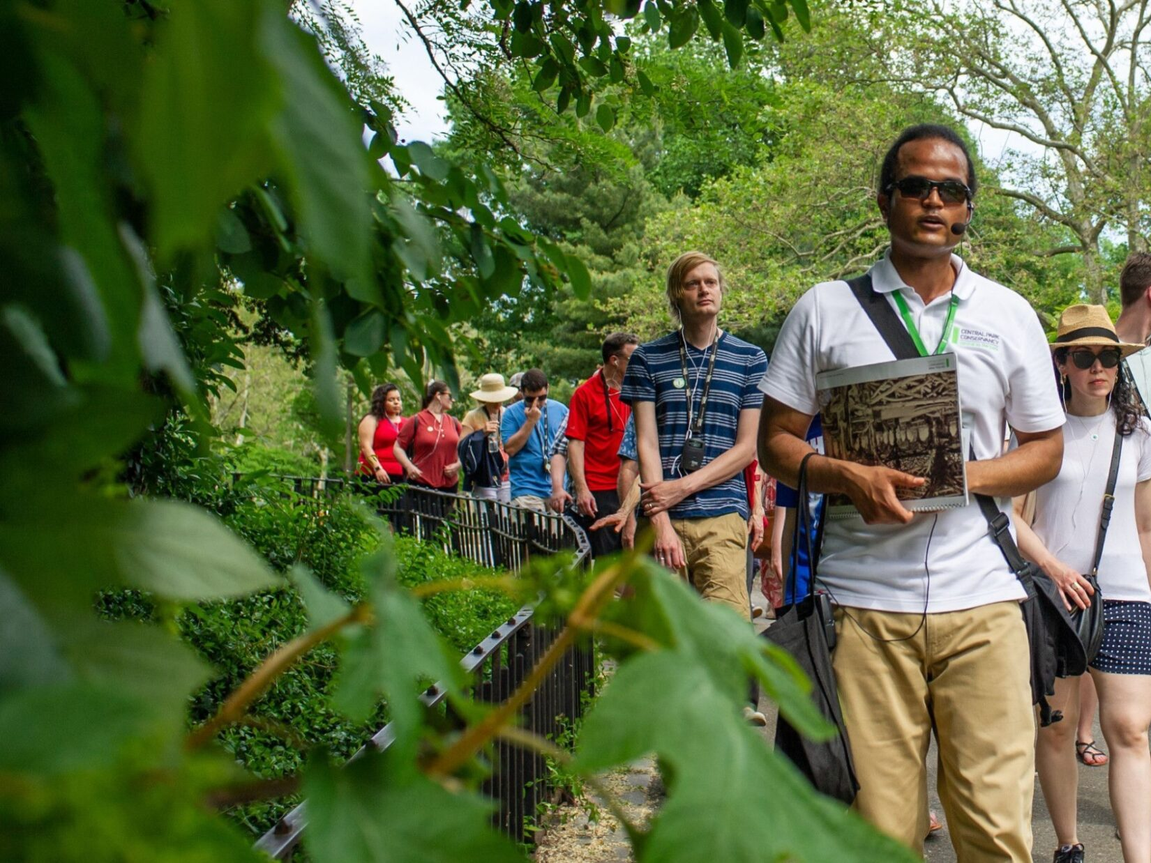 A Conservancy tour guide leads park goers on a tour through the southern end of the Park.