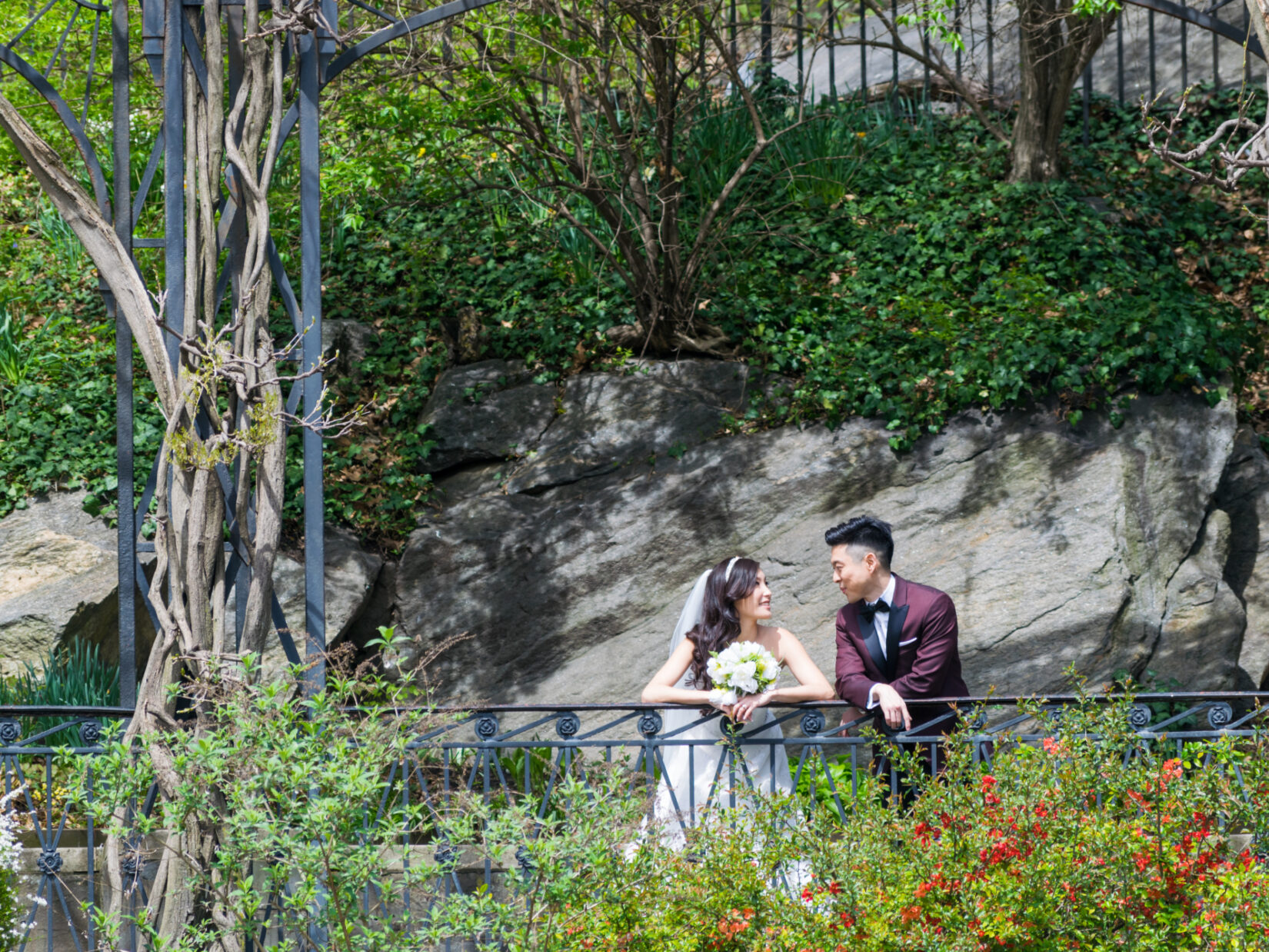 A bridge and groom in a casual moment in Conservatory Garden
