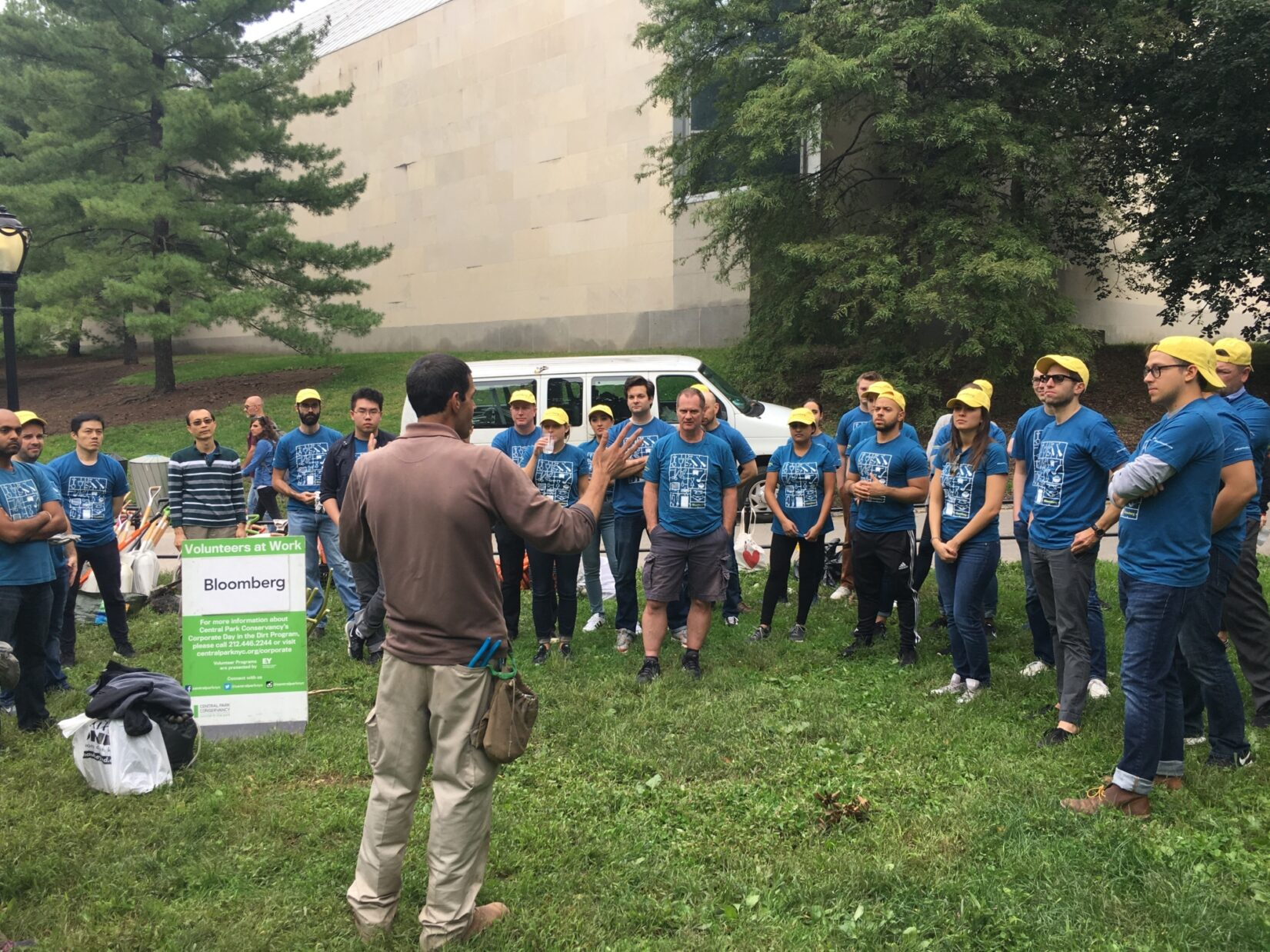 Volunteers from Bloomberg receive instructions before starting their day of volunteering