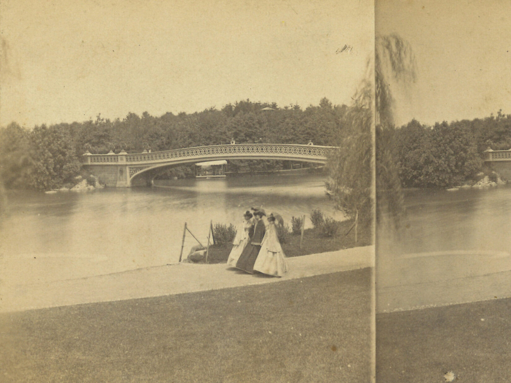 A view across the Lake looking toward Bow Bridge in 1872.