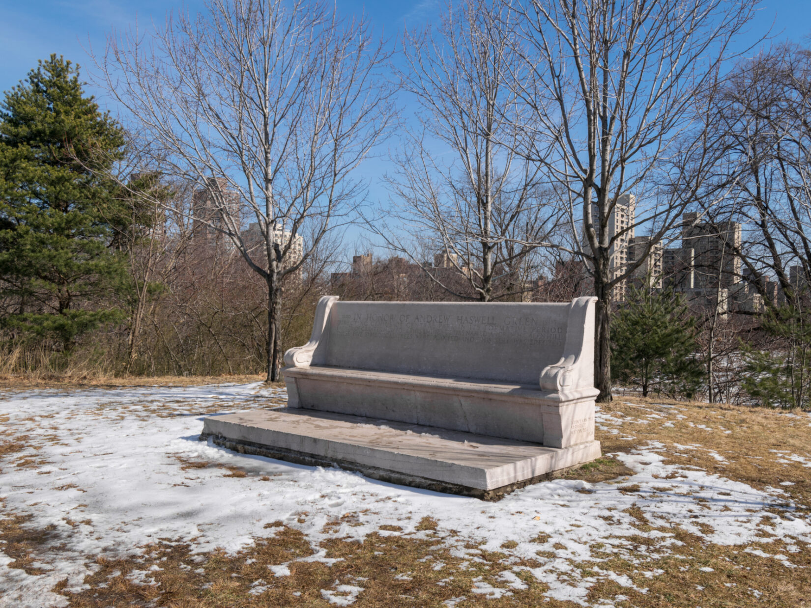 The landscape of Fort Fish, featuring the Andrew Haskell Green bench