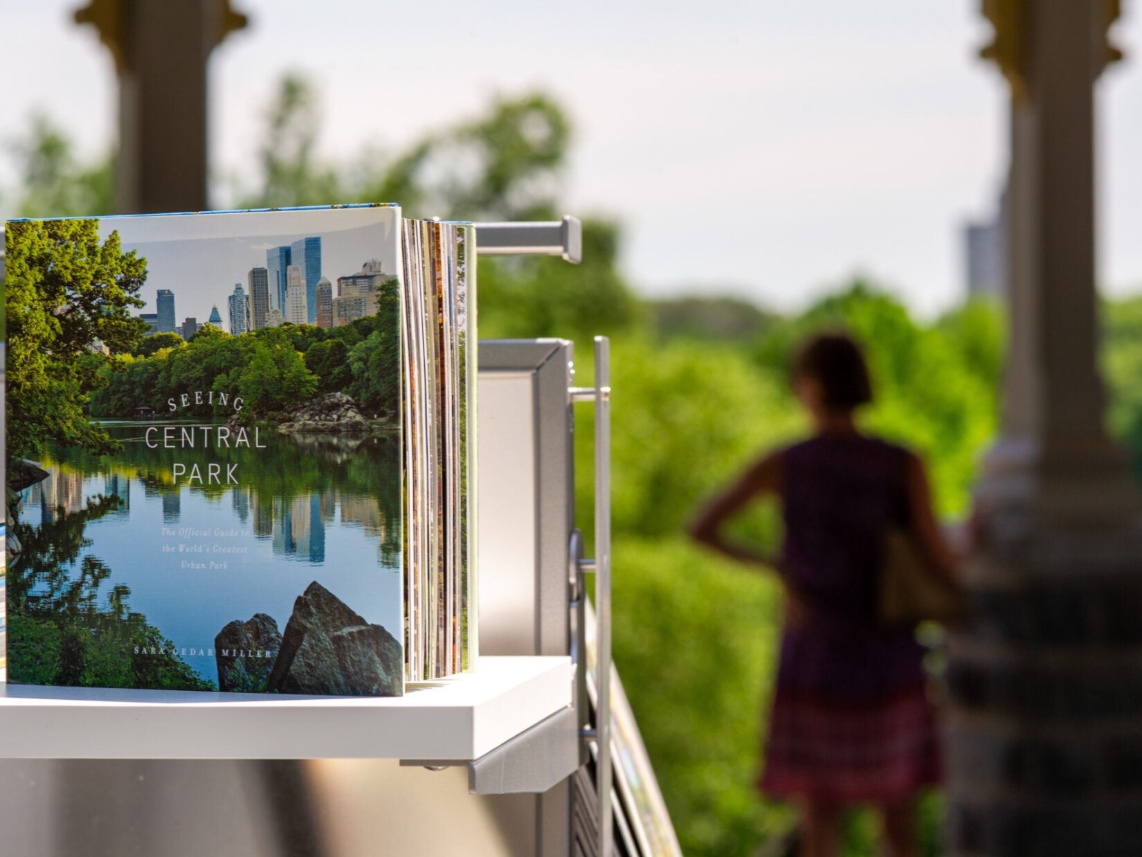 A picture book on sale at the gift shop, with the greenery of the Park in the background