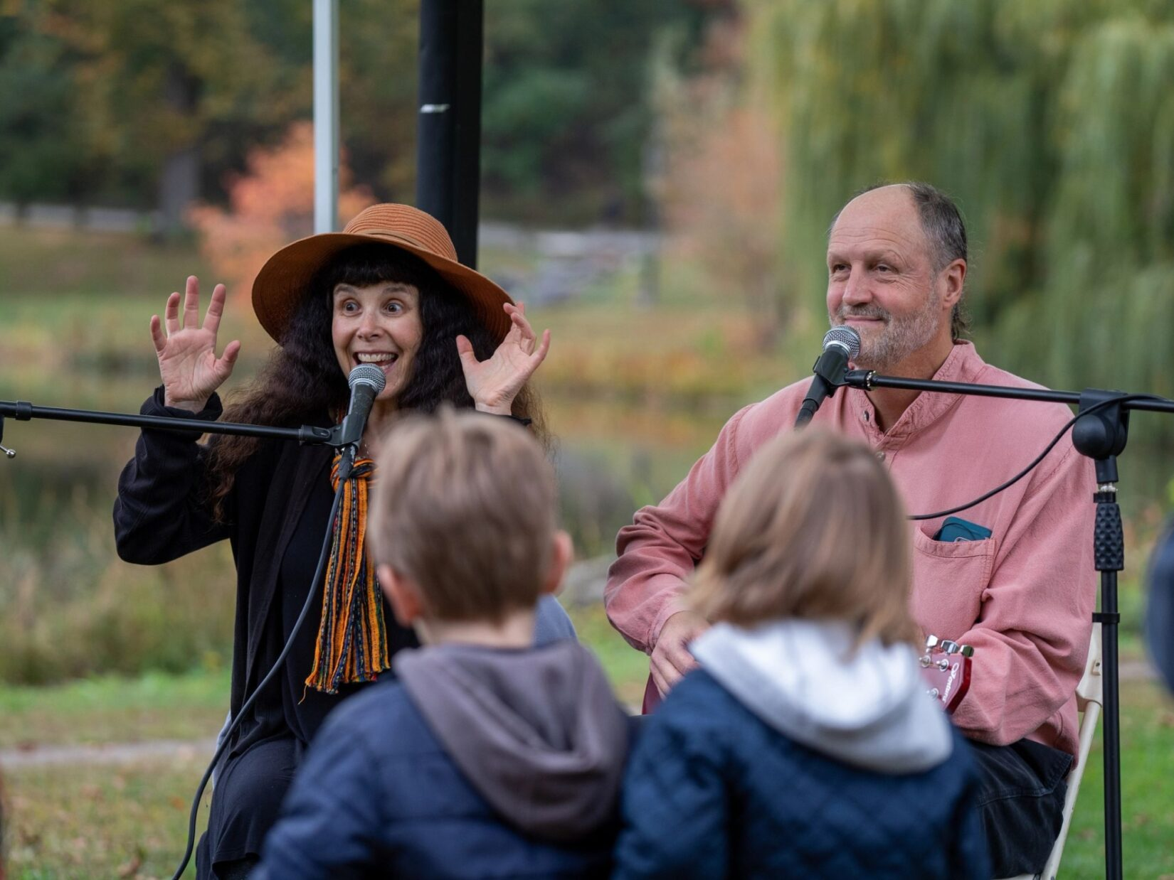 A man and a woman, neither particularly spooky, entertain the crowd with Halloween songs.