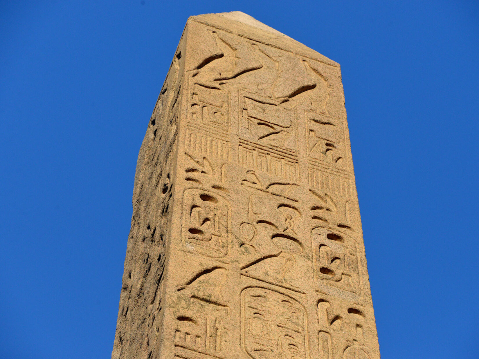 A detail view of the top of the Obelisk, showing heiroglyphs in relief