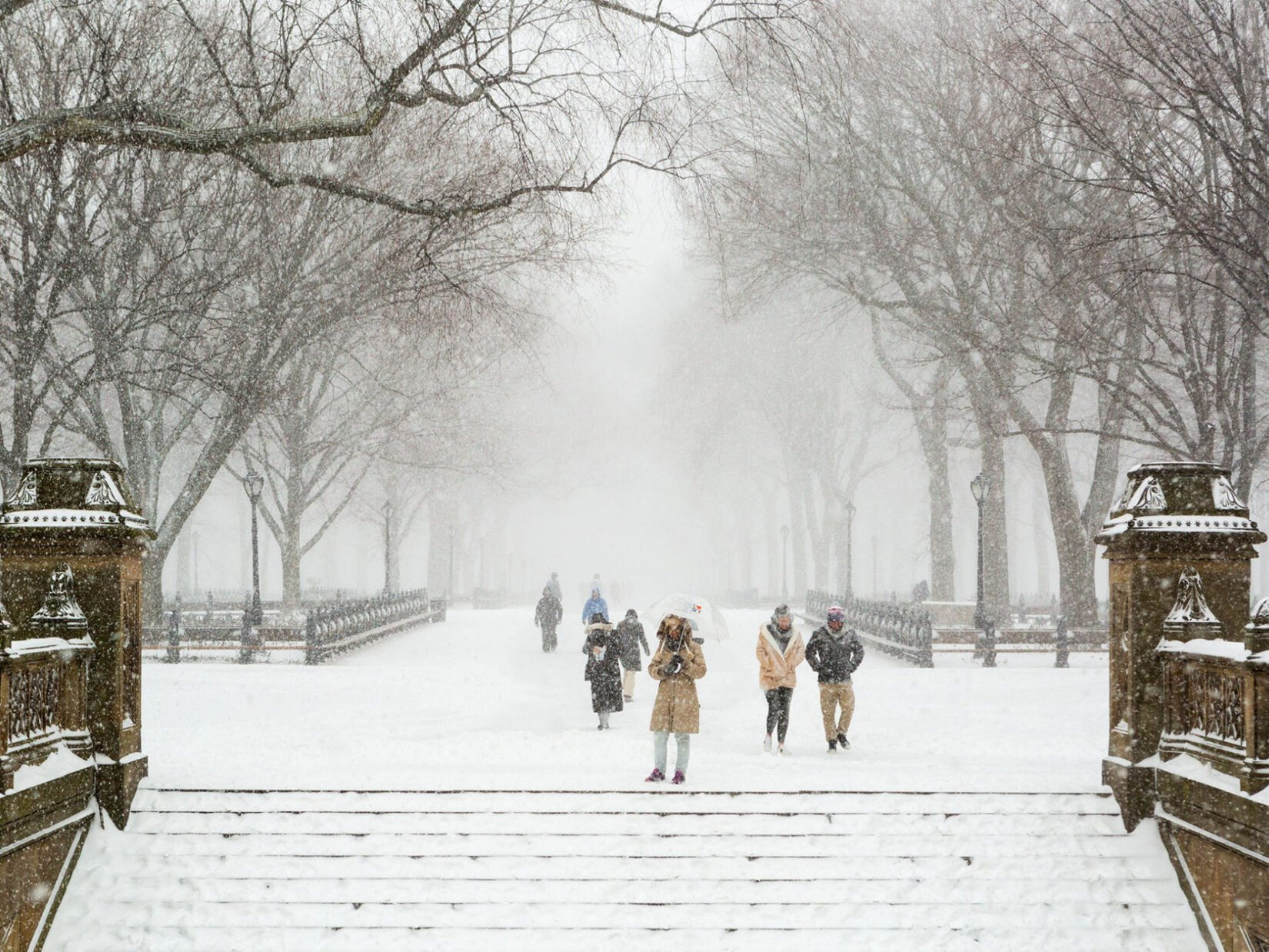A view looking down the Mall from the steps of Bethesda Terrace on a snowy winter day