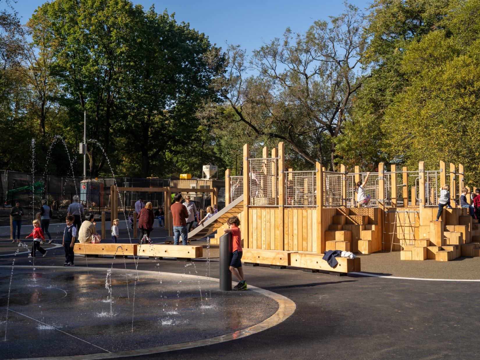 Children enjoying the Kempner Playground's wooden apparatus