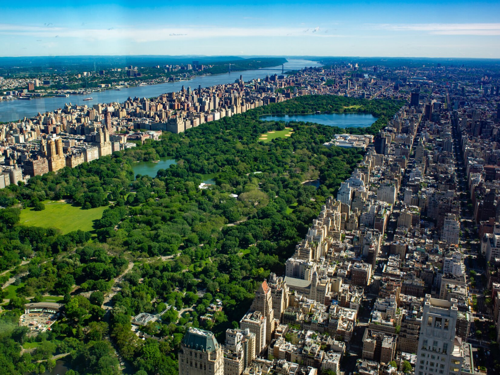 An aerial view of the park showing it's full length, looking north toward Harlem.