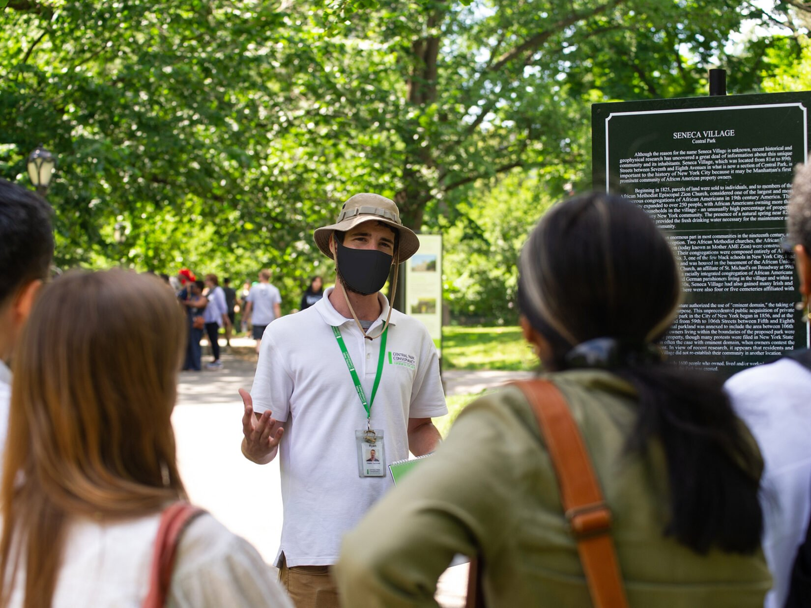A Conservancy guide addresses a tour group at the Seneca Vaillage site