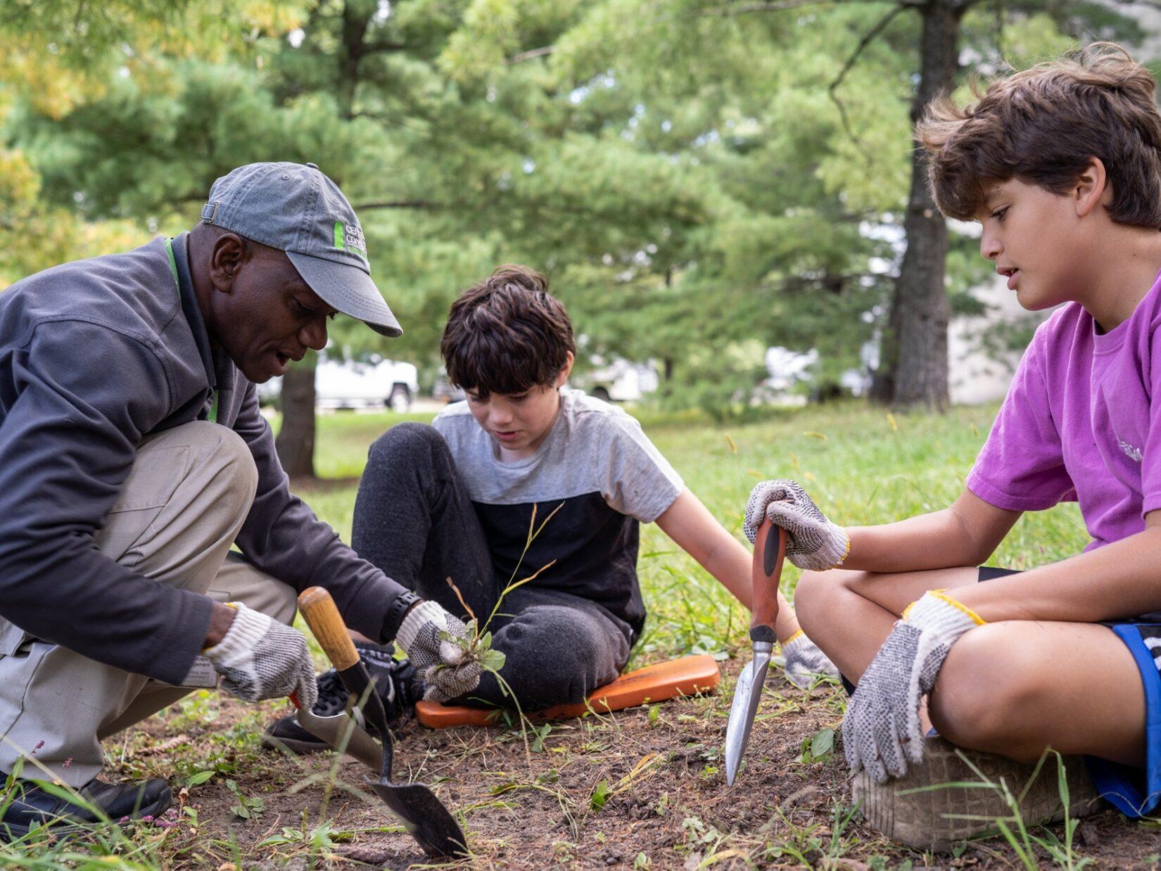 Conservancy staff member William Quansah working with some school group volunteers