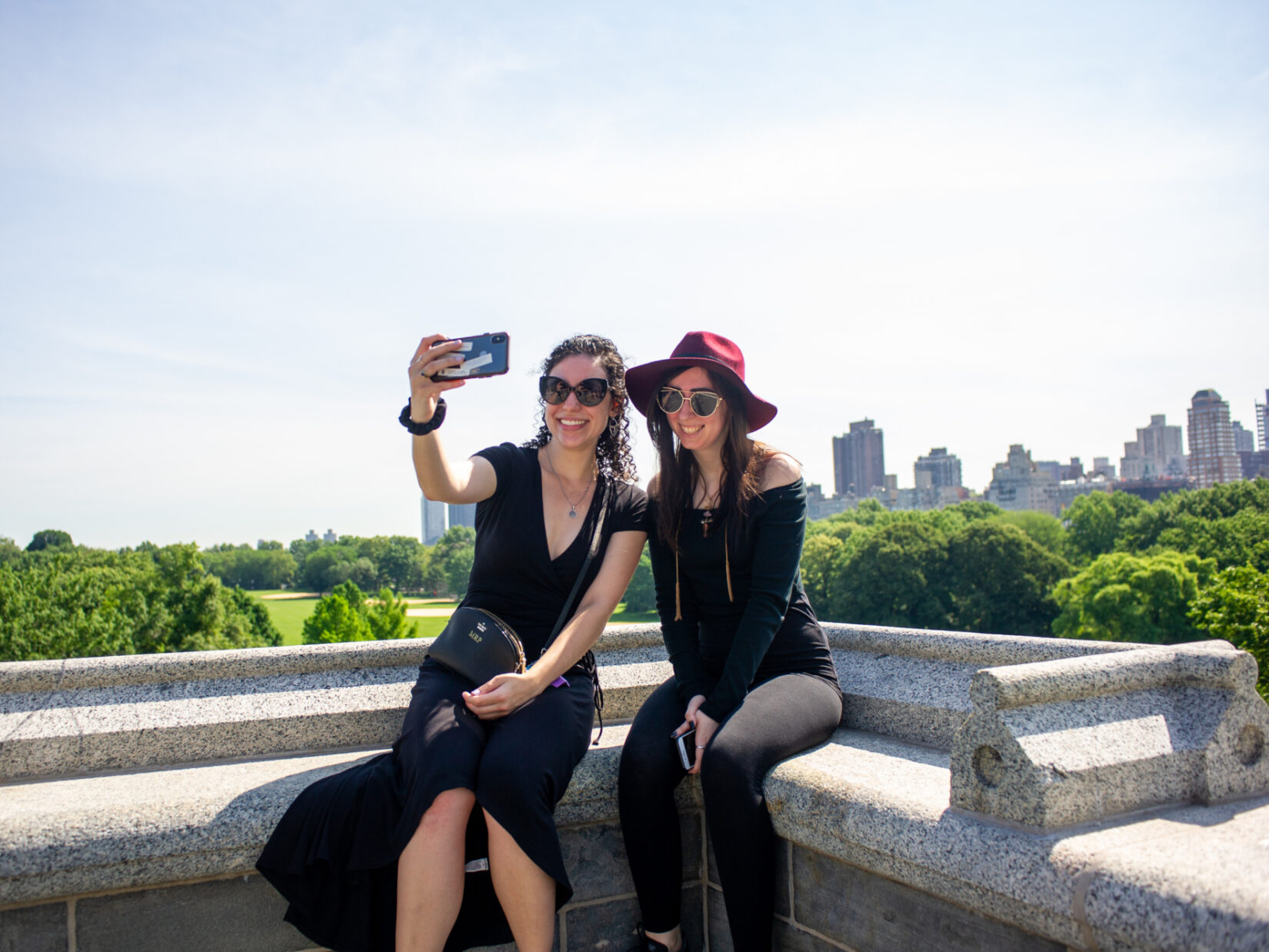 Two young women pose for a selfie atop Belvedere Castle