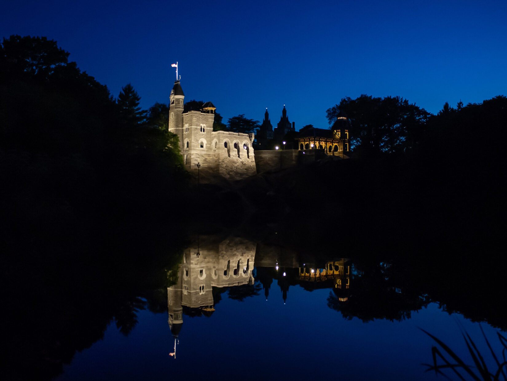 The Castle seen from across Turtle Pond, lit dramatically at night