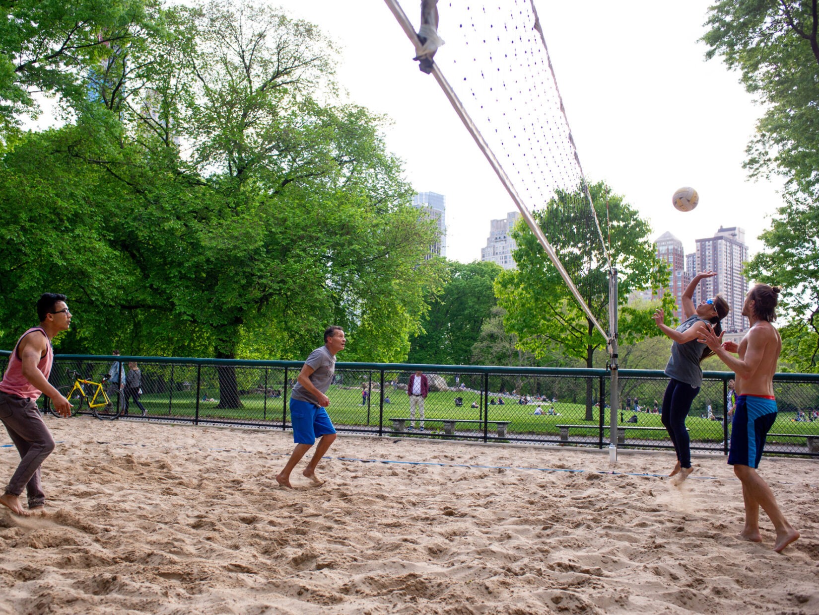 Four players squaring off on the volleyball court
