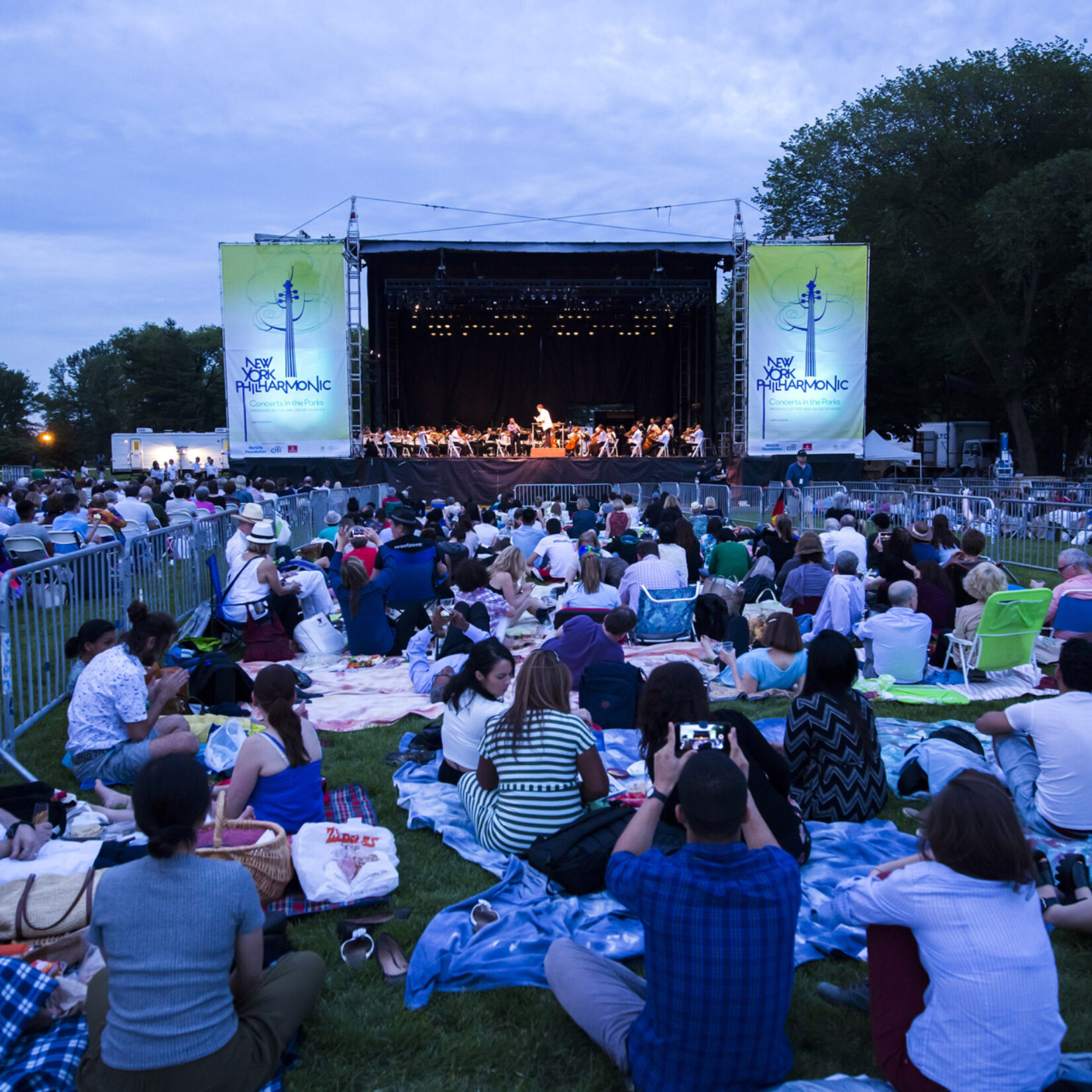New York Philharmonic performs in Central Park on a summer evening