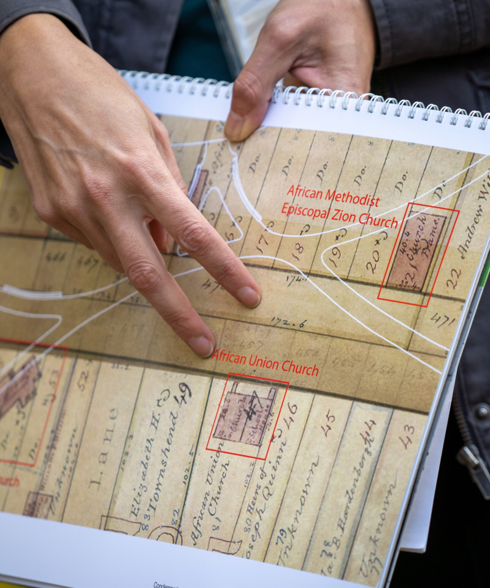 Detail of a Conservancy guide pointing out the details of a contemporary map of Seneca Village