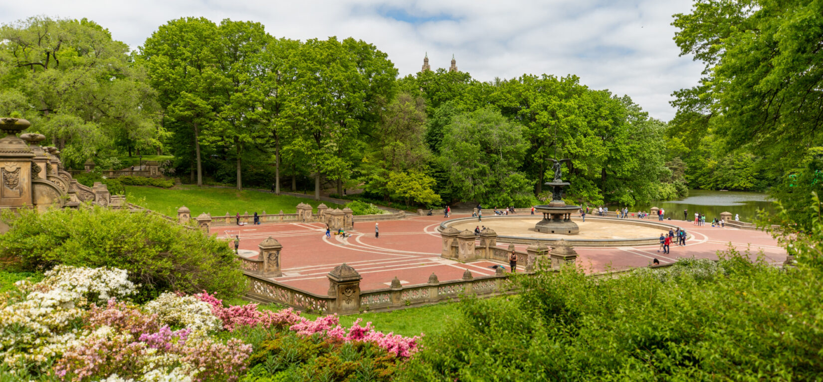 Bethesda Terrace embedded in the lush green foliage of summer