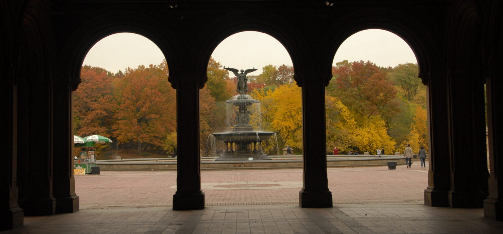 Looking through the shadowed arches of the Arcade to Bethesda Terrace