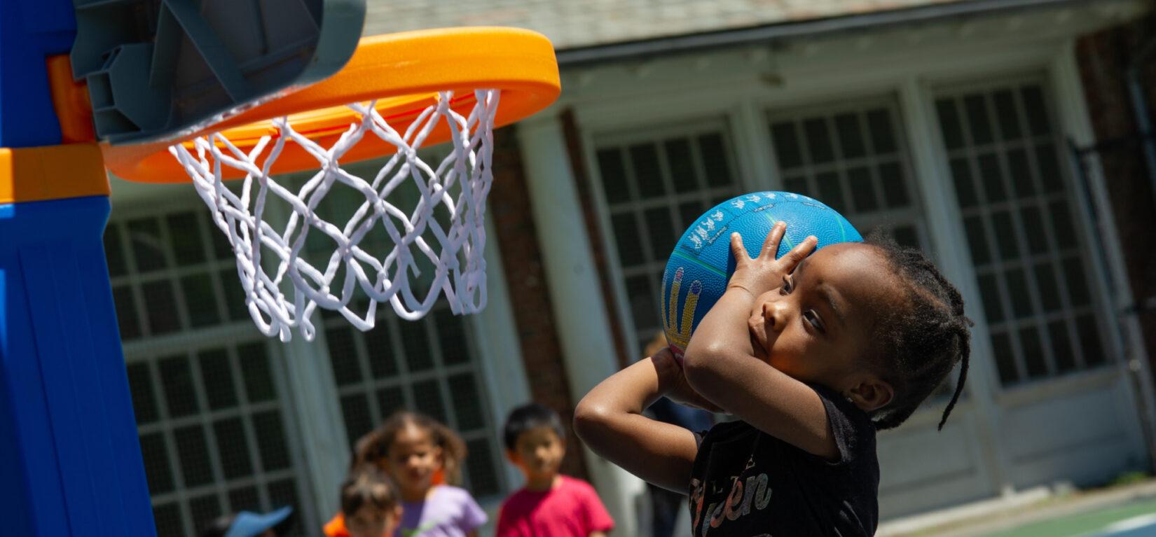 A future WNBA star prepares to shoot a basket