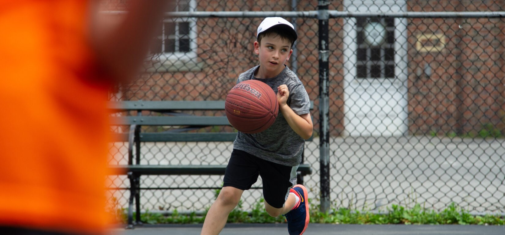 A young baller caught in mid-dribble