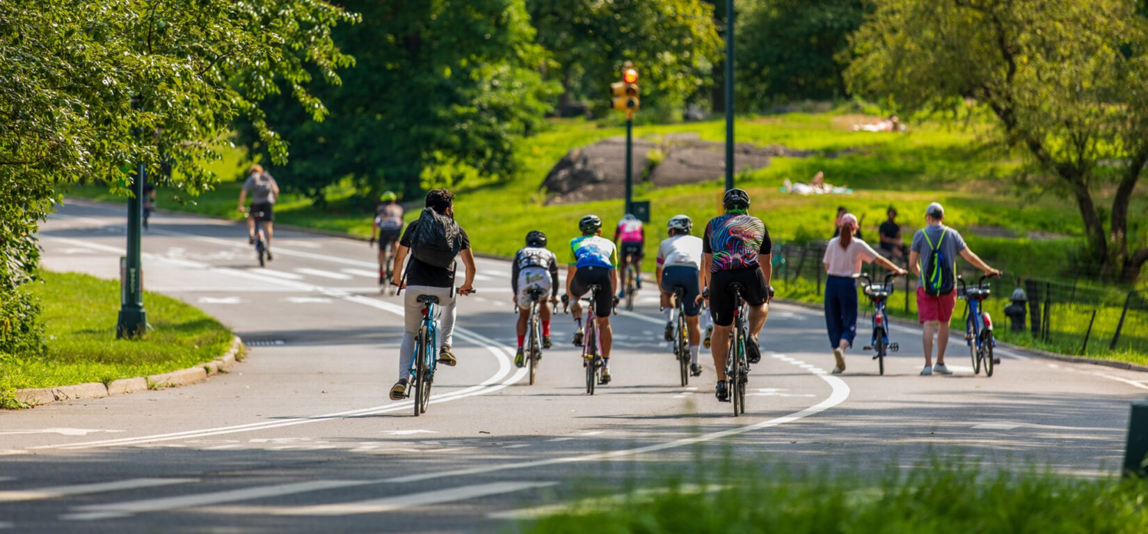 Bicyclists using the bike lanes of the roadway that circles the Park
