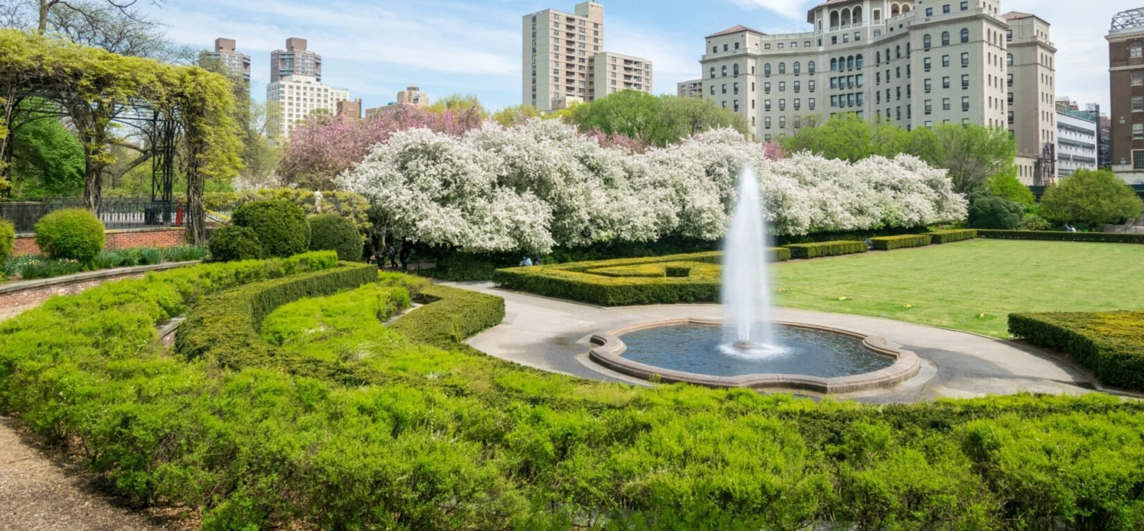 A view of Conservatory Garden featuring the fountain and a section of the pergola