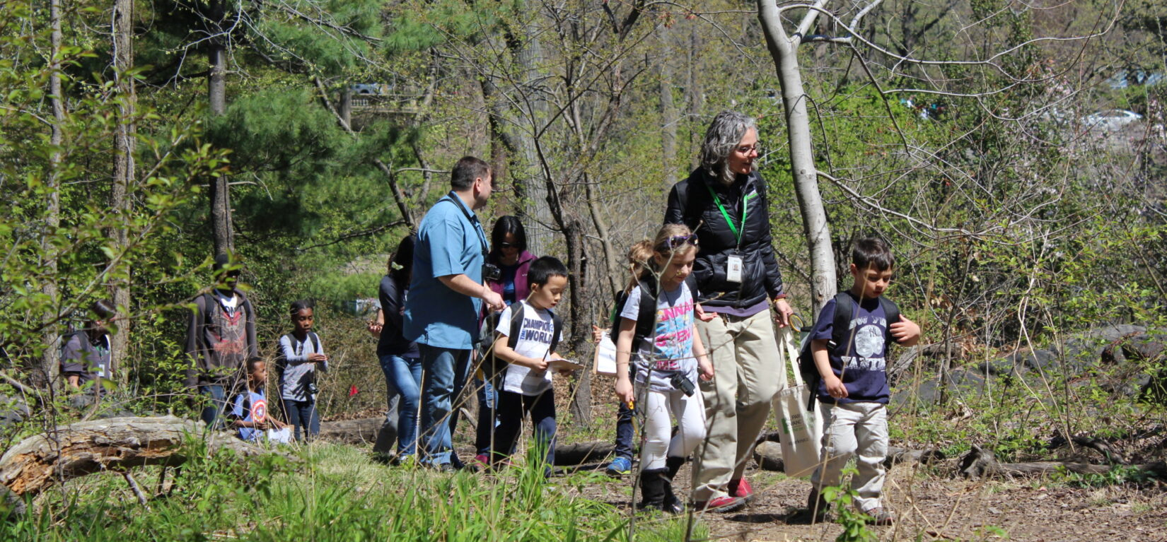 Families taking a woodland tour with a Conservancy guide