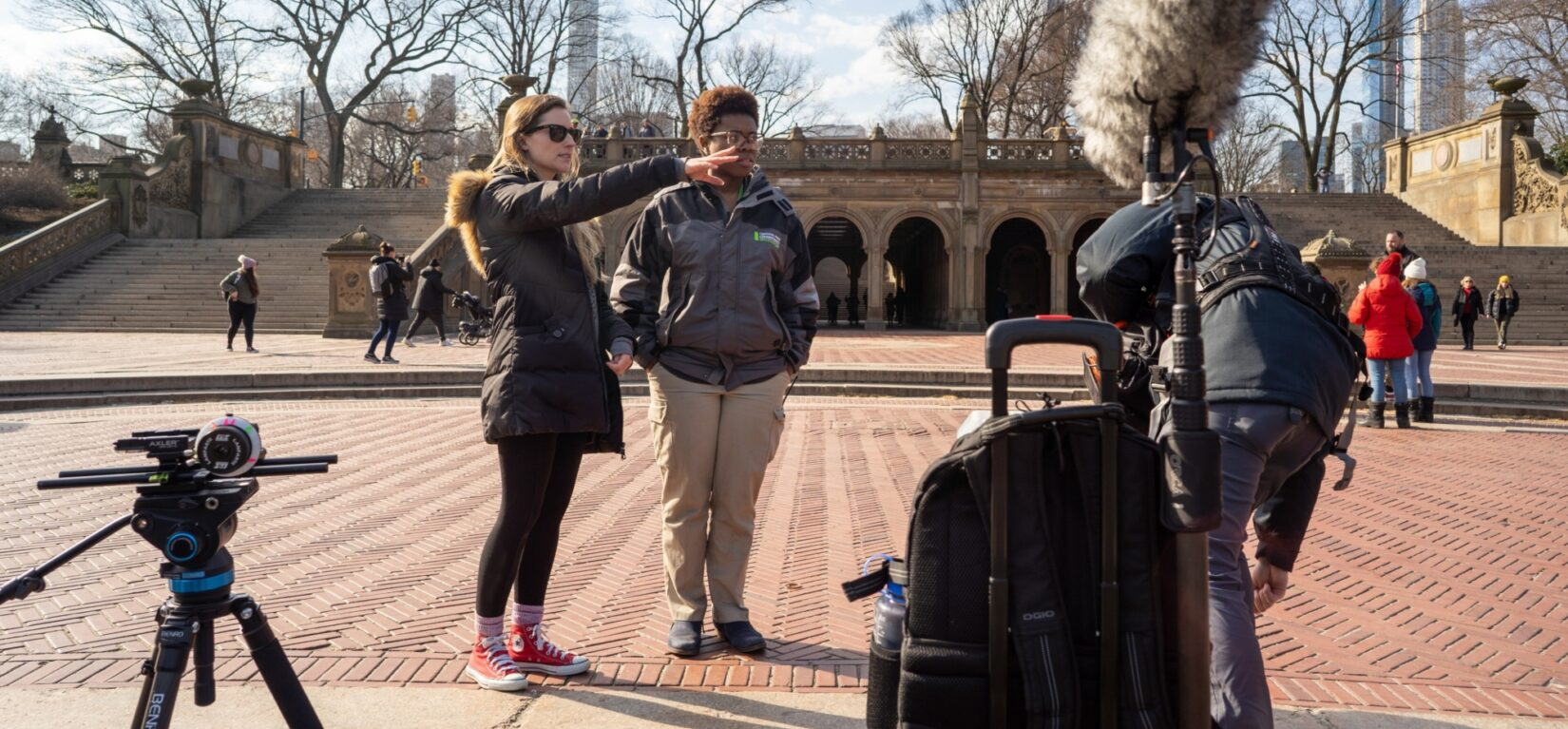 Two women map out a film shoot on Bethesda Terrace in winter