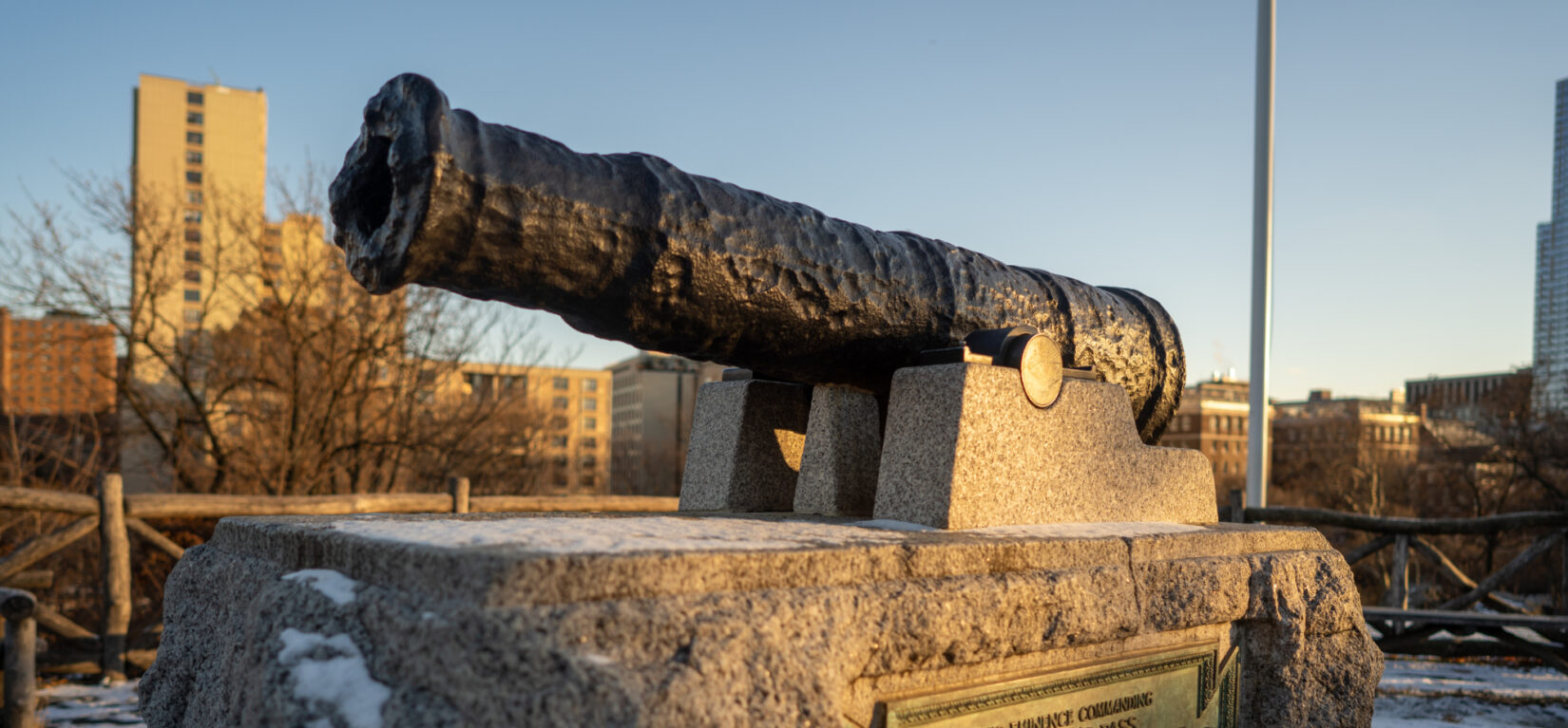 A canon commemorates the location of McGowan's Pass, with a slice of the Harlem skyline in the background.