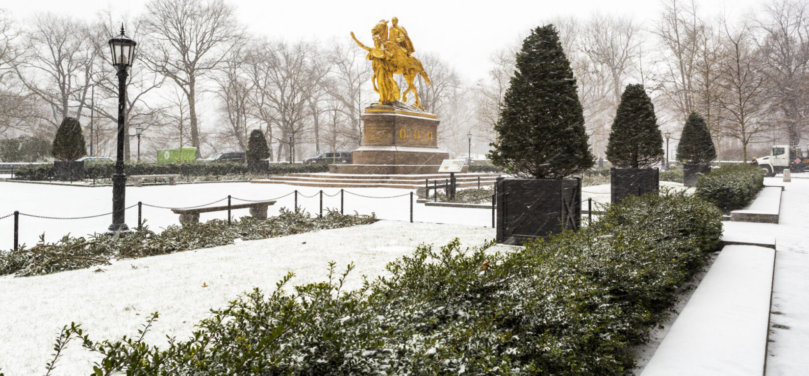 The statue of General Sherman is the focal point of Grand Army Plaza dusted with snow