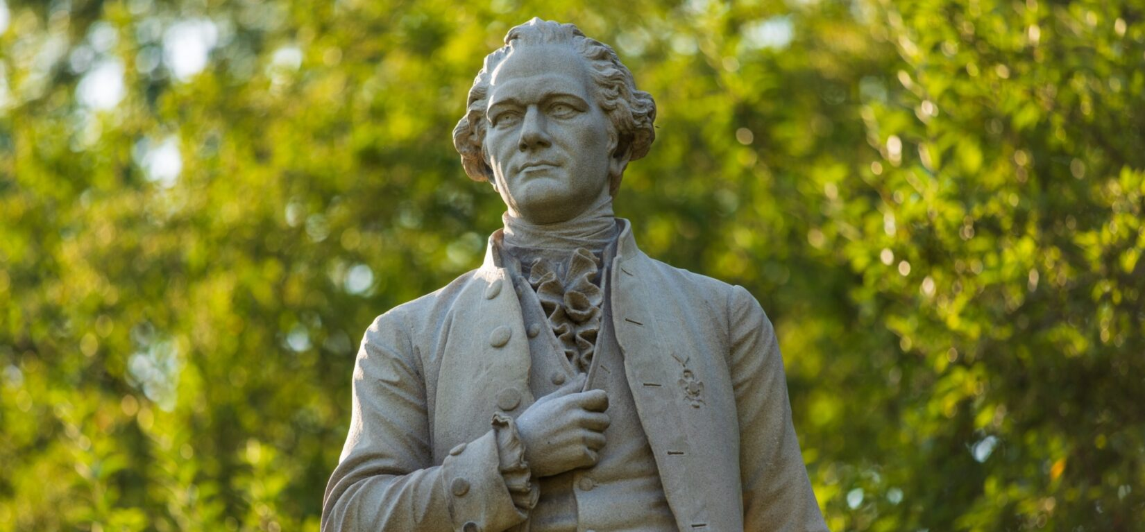 Close-up shot of the statue showing Hamilton in a frock coat