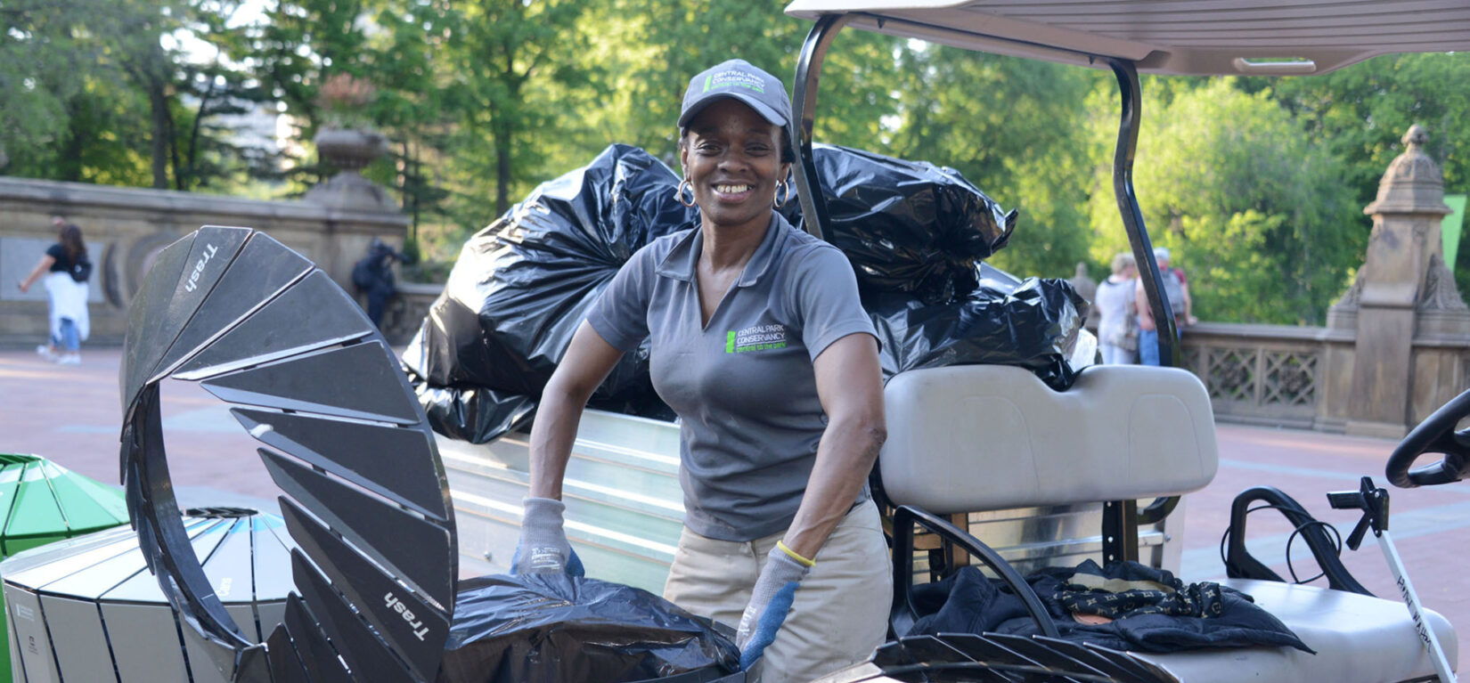 A member of the Conservancy staff emptying trash bins