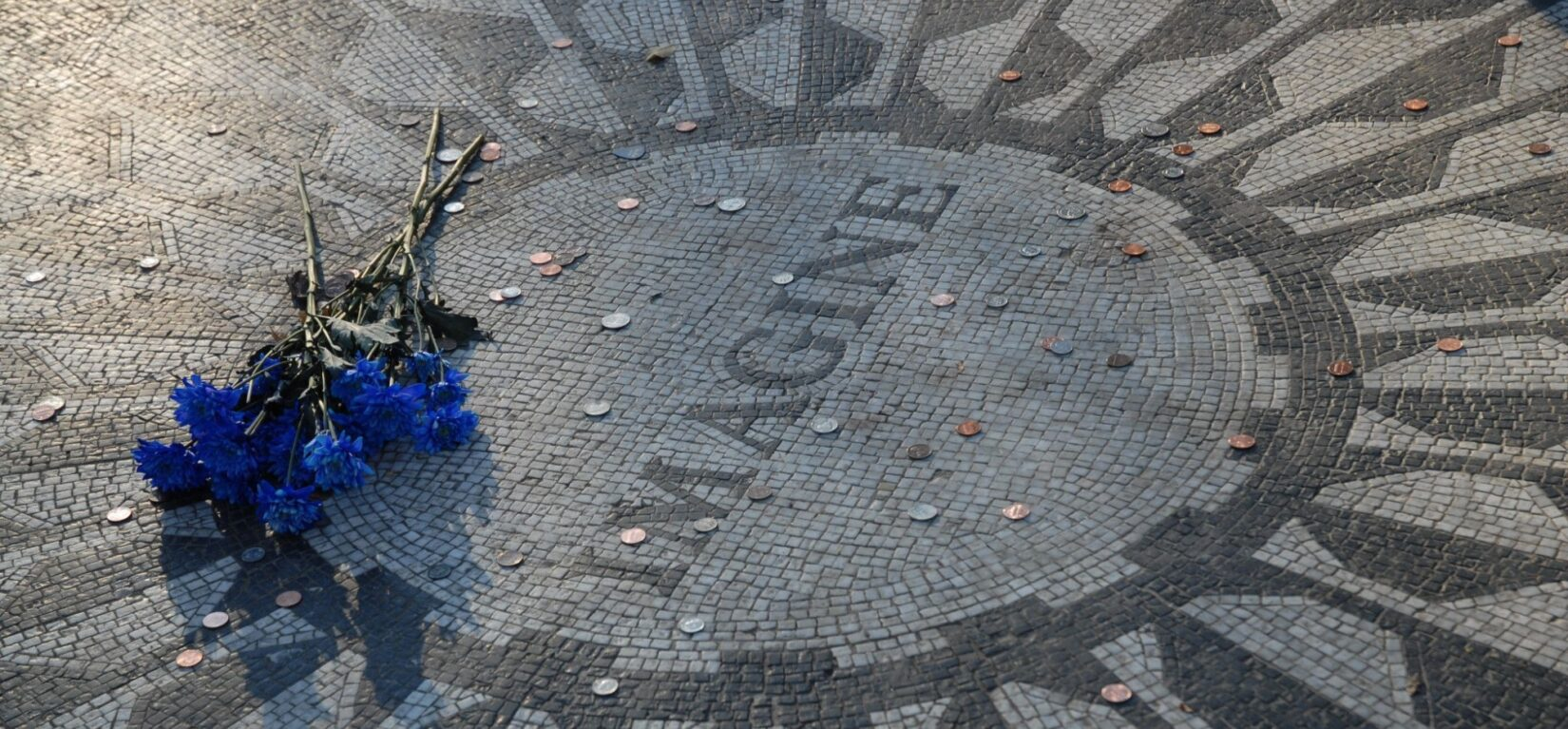 A clutch of flowers is left in tribute at the Imagine mosaic