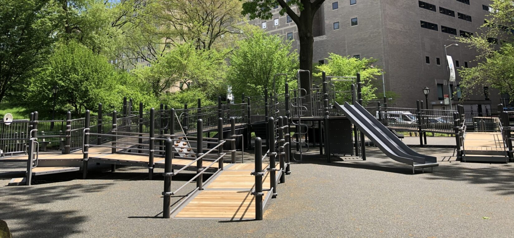 The playground is seen with apartment buildings in the background, showing how available it is to the community.