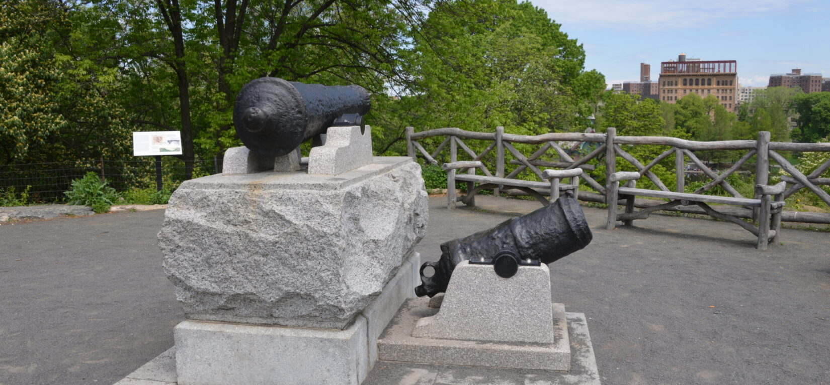 Two antique canons on rough-hewn stone foundations commemorate the Fort Clinton landscape.