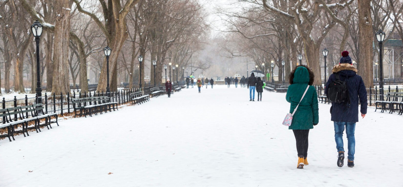 A couple walk down the Mall after a snowfall