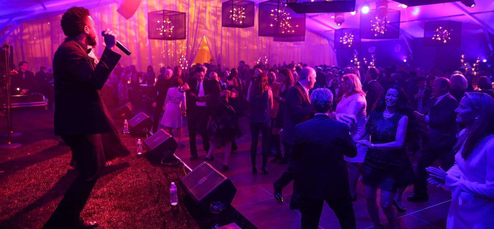 An entertainer keeps celebrating donors dancing
