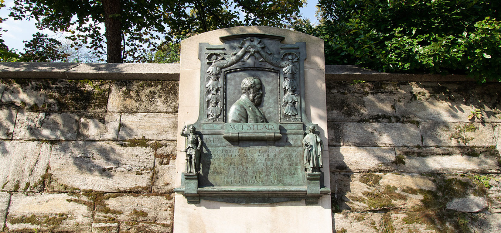 The memorial plaque viewed on the perimeter in summer