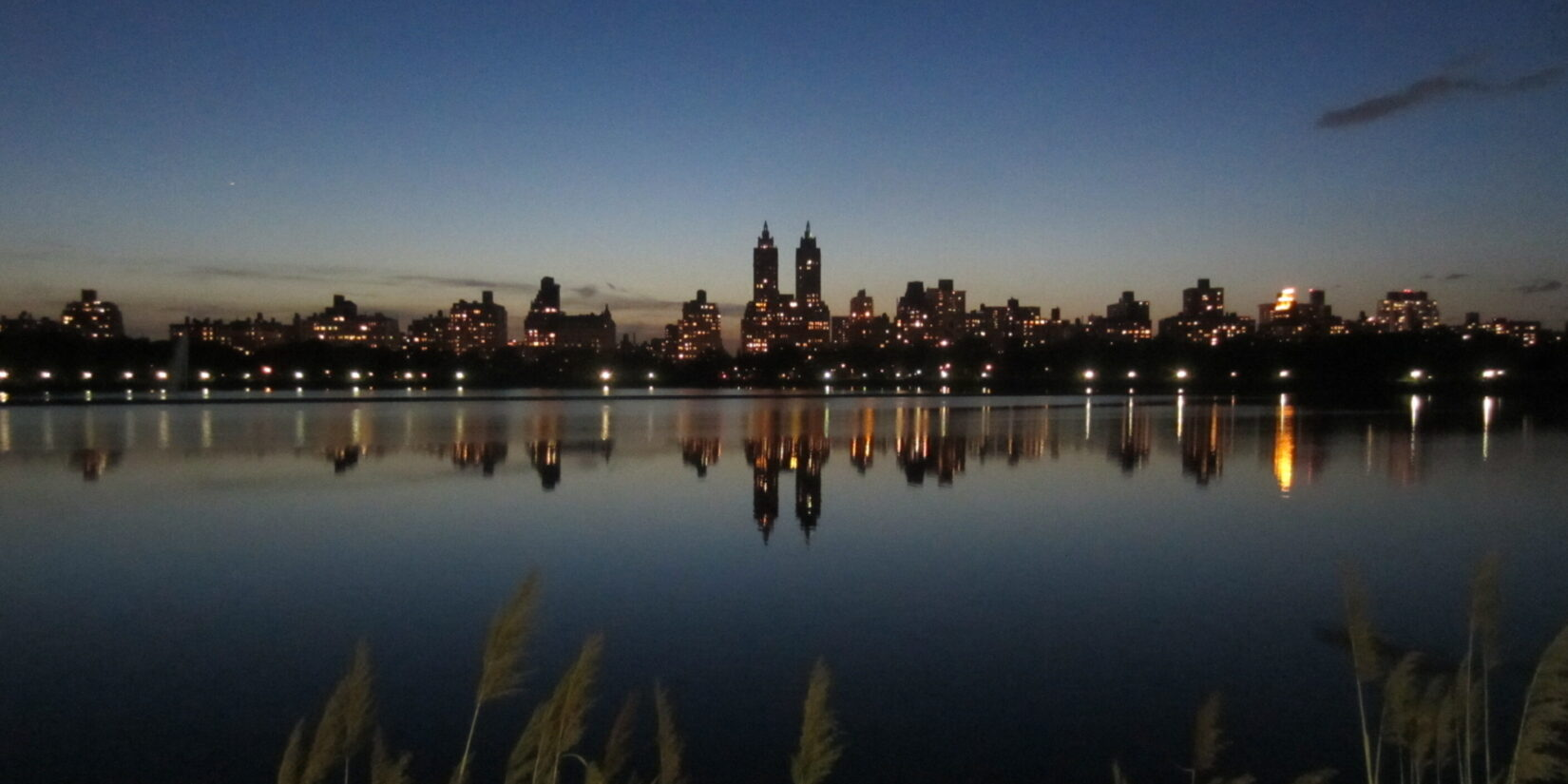 The skyline reflected on the water of the Reservoir, at dusk